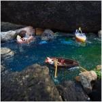 Miniaturfiguren in Booten